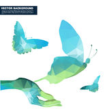 Polygon butterfly and hand concept. Royalty Free Stock Photography