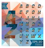 Polygonal alphabet, faceted capital letters on abstract   Royalty Free Stock Image