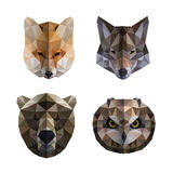 Polygonal animal heads. Low polygon animal heads logos. Triangular geometric set. Bear, owl, fox and wolf. Vector illustration Royalty Free Stock Photography