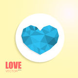 Polygonal blue heart on cut out white circle paper. Isolated on beige background with inscription Stock Photo