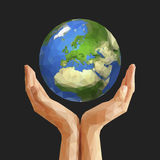 Polygonal cupped hands that hold polygon planet earth europe gra Stock Images