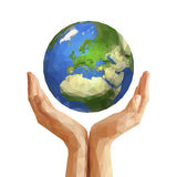 Polygonal cupped hands that hold polygon planet earth europe whi Stock Images