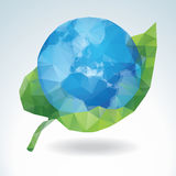 Polygonal Earth with green leaf Stock Photos