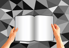 Polygonal hands holding an open book with blank pages Stock Photos