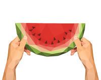 Polygonal hands to keep low poly slice of watermelon on a white Royalty Free Stock Photography