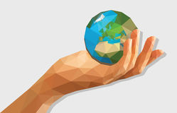 Polygonal low poly disclosed cupped left hand holding a globe is Royalty Free Stock Images