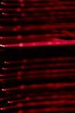 Polygonal röda kulöra ljusa strålar Arkivfoton