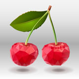 Polygonal red cherry berries with green leaves. Stock Photos