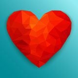 Polygonal red heart. Vector illustration. Polygonal heart. Low poly design on blue background with shadow. Abstract red shape. Vector illustration Stock Photography