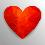 Polygonal red heart. Vector illustration. Polygonal red heart. Low poly design on gray background with shadow. Abstract shape. Vector illustration Stock Photos