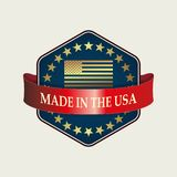 A polygonal sign of a blue hue with a red ribbon. A polygonal sign of a blue hue with a red ribbon with text and a silhouette of the US flag Royalty Free Stock Images