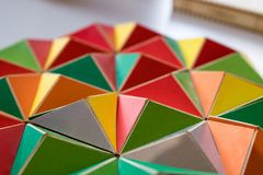 Polygonal surface with colored triangles, tessellation of a thre. E-dimensional floor with colored polygons. decoration with pyramids and colors, mathematical Royalty Free Stock Images