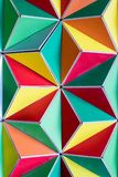 Polygonal surface with colored triangles, tessellation of a thre. E-dimensional floor with colored polygons. decoration with pyramids and colors, mathematical Stock Photo