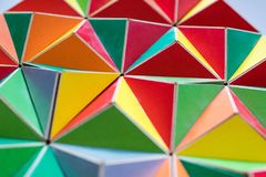 Polygonal surface with colored triangles, tessellation of a thre. E-dimensional floor with colored polygons. decoration with pyramids and colors, mathematical Stock Images