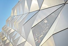 Polygonal triangle glass facade of modern building. Stock Images