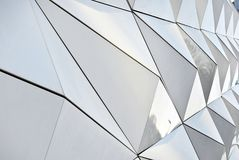 Polygonal triangle glass facade of modern building. Royalty Free Stock Photography
