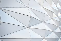 Polygonal triangle glass facade of modern building. Stock Photography