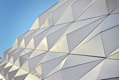 Polygonal triangle glass facade of modern building. Stock Photo