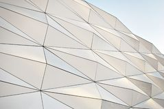 Polygonal triangle glass facade of modern building. Royalty Free Stock Photos