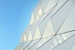 Polygonal triangle glass facade of modern building. Stock Image