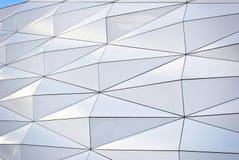 Polygonal triangle glass facade of modern building. Royalty Free Stock Photos
