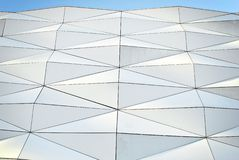Polygonal triangle glass facade of modern building. Royalty Free Stock Image