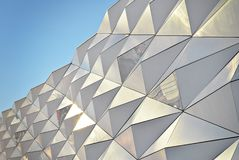 Polygonal triangle glass facade of modern building. Royalty Free Stock Photo