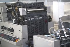 Polygraphic machine in a modern printing house. Close up Royalty Free Stock Photo