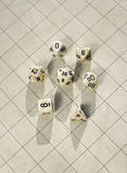 Polyhedral dice on blank roleplay game grid Stock Photography