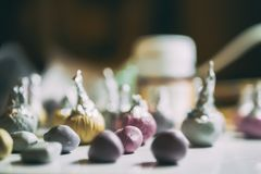 Polymer clay craft. Color buds of polymer clay in the working place royalty free stock photography