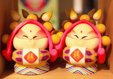 Polymer clay. The polymer clay figure is a traditional handmade toy, people buy it for child and make a good wish in the chinese new year.We can also put it on Stock Photo