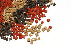 Polymer resin brown/red. Brown and red coloured polymer resins for injection moulding Stock Images