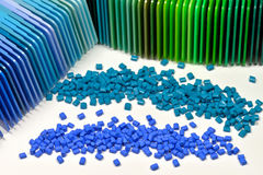 Polymer with samples. Polymer resin dyed in two different blue colors with correspondending color samples Royalty Free Stock Image