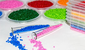 Polymeric dye. Colorant for plastics. Pigment in the granules. Polymeric dye. Plastic pellets. Colorant for plastics. Pigment in the granules Royalty Free Stock Photo