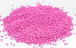 Polymeric dye for plastics. Pigment in the granules. Plastic granules Stock Photo