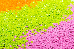 Polymeric dye for plastics. Pigment in the granules. Plastic granules Stock Images