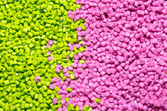 Polymeric dye for plastics. Pigment in the granules. Plastic granules Royalty Free Stock Image