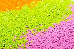 Polymeric färg för plast- Pigment i partiklarna Plast- partiklar Arkivbild
