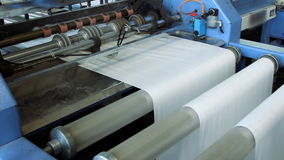 Polymeric tape roll unreel for a printing press stock video
