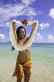 Polynesian beauty at the beach. Beautiful polynesian girl on the beach in Hawaii holding a flower lei Royalty Free Stock Photos