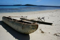 Polynesian canoe on beach Royalty Free Stock Photos