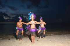 Polynesian Cook Islander dancers dancing on Muril beach lagoon i. Young attractive and exotic Polynesian Cook Islander dancers male and female dancing on Muril Stock Photos