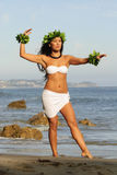 Polynesian Dancer. Beautiful young Polynesian woman performing traditional dance on beach Royalty Free Stock Photography