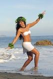 Polynesian Dancer. Beautiful young Polynesian woman performing traditional dance on beach Stock Photography