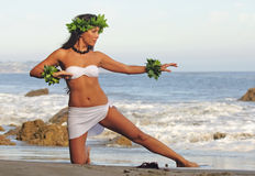 Polynesian Dancer. Beautiful young Polynesian woman performing traditional dance on beach Royalty Free Stock Image