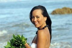 Polynesian Dancer. Beautiful young hawaiin woman on the beach Stock Image