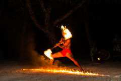 Polynesian fire dancer Stock Images