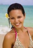 Polynesian girl in a pink bikini by ocean Stock Photography