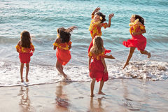 Polynesian Hula girls  in jumping in the ocean Royalty Free Stock Photo