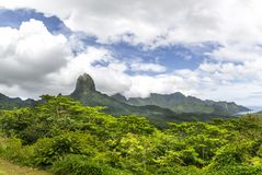 Polynesian Landscape. Rugged, mountainous landscape of Moorea in French Polynesia and the mountain of Bali Hai Stock Images